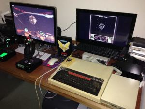 Docking at a Coriolis station in the original Elite on a BBC Micro and in Elite:Dangerous on a PC.