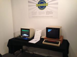 "The Sinclair QL and BBC Micro doing public duty in the ""Geek is Good"" exhibition. (Sorry for the camera shake.)"